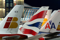 Logos d'Iberia, British Airways et American Airlines